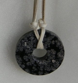Fossilized coral donut pendant with soft deer skin cord necklace