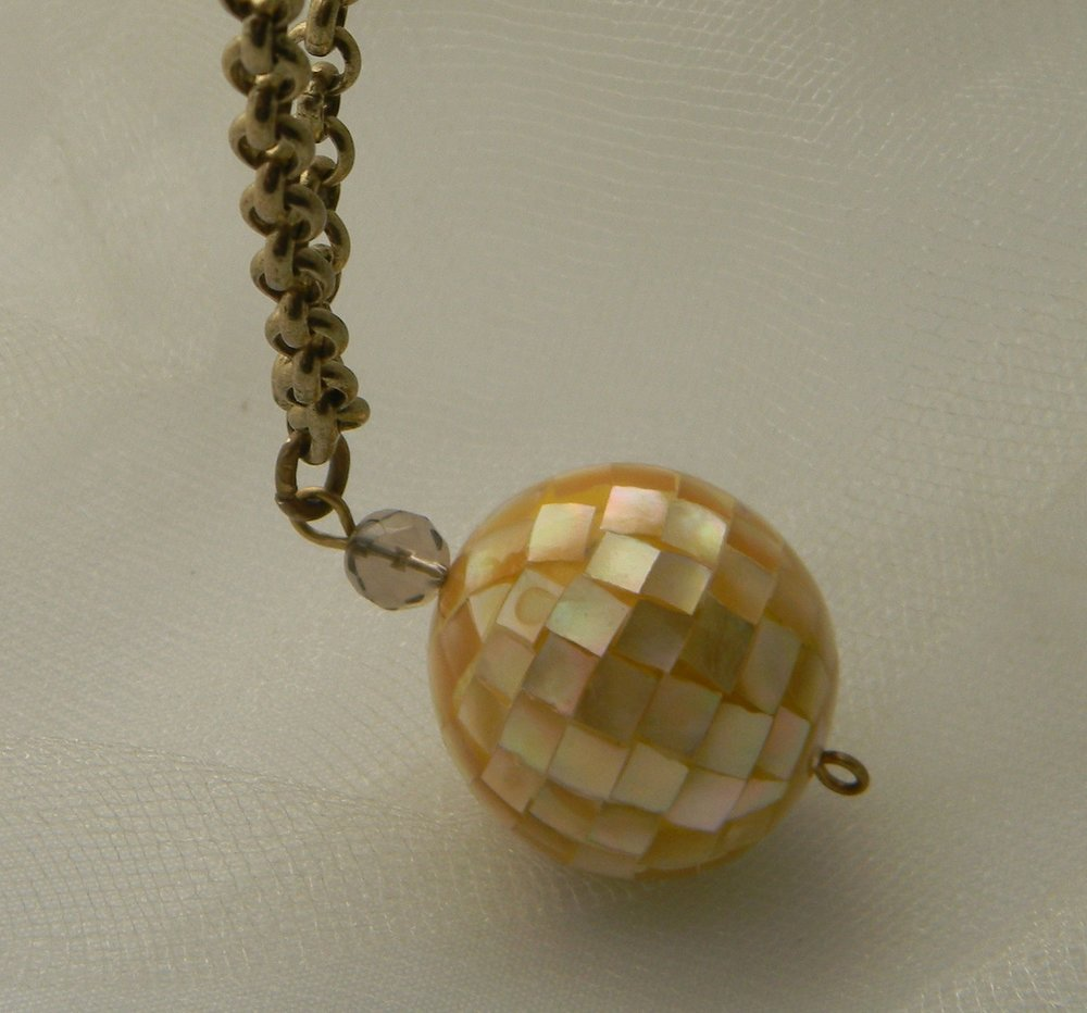 Golden mother of pearl mosaic ball pendant on brass chain necklace