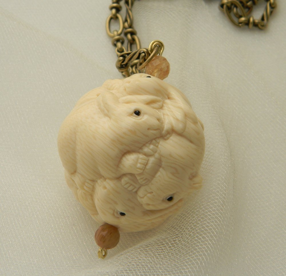 NEW: Resin & bone rabbits ball pendant on designer brass chain necklace