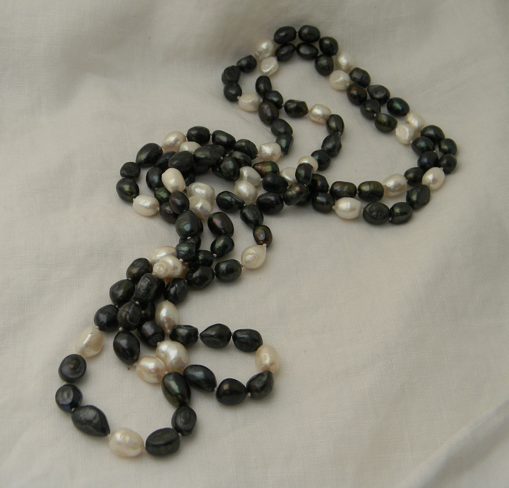Fresh water pearl bi color single strand endless necklace for women , hand knotted cultured asymmetrical dark peacock gray & cream pearls