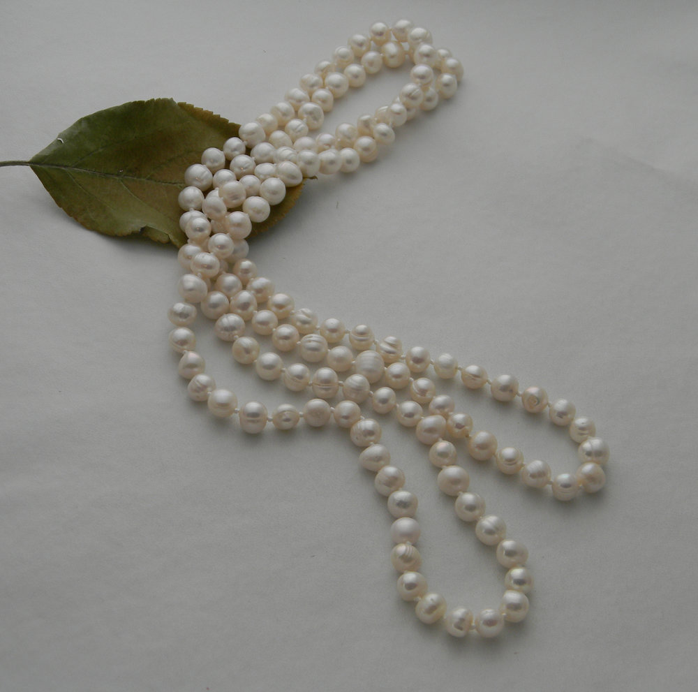 Fresh water pearls necklace , silk hand knotted pale ivory cultured asymmetrical pearls ,