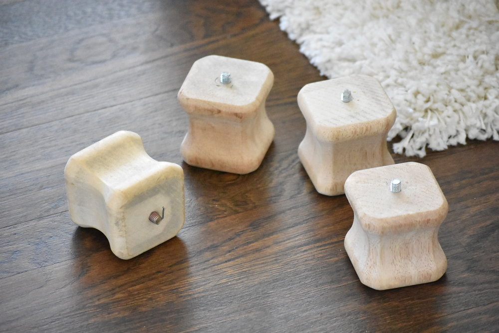 I found these wooden furniture feet at home depot for $5.98 each .