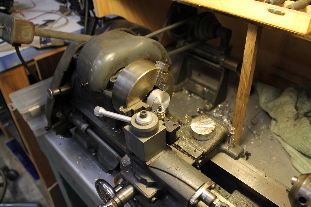 Turning custom shaft collars for the BNPF hip hub on my little vintage Craftsman lathe.