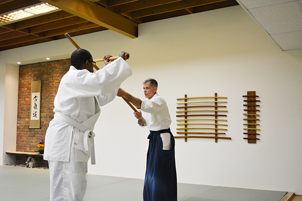 Joe Heim and white belt student traditional weapons photo
