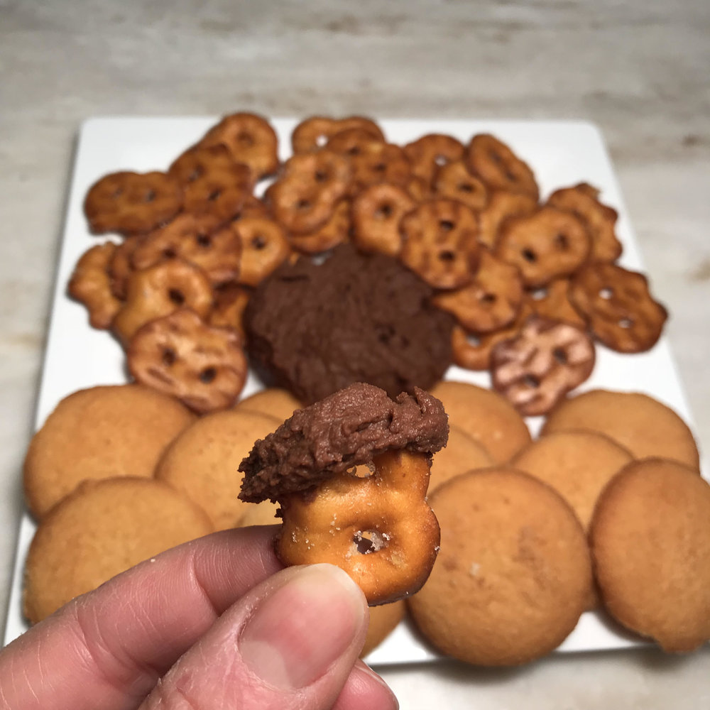 Chocolate:  this delectable dessert hummus tastes like dark chocolate. You won't believe you're actually eating hummus. It is very versatile and can be enjoyed with berries, apples, pretzels, vanilla wafers, and graham crackers. You can also ice your favorite cookies and cupcakes with it.