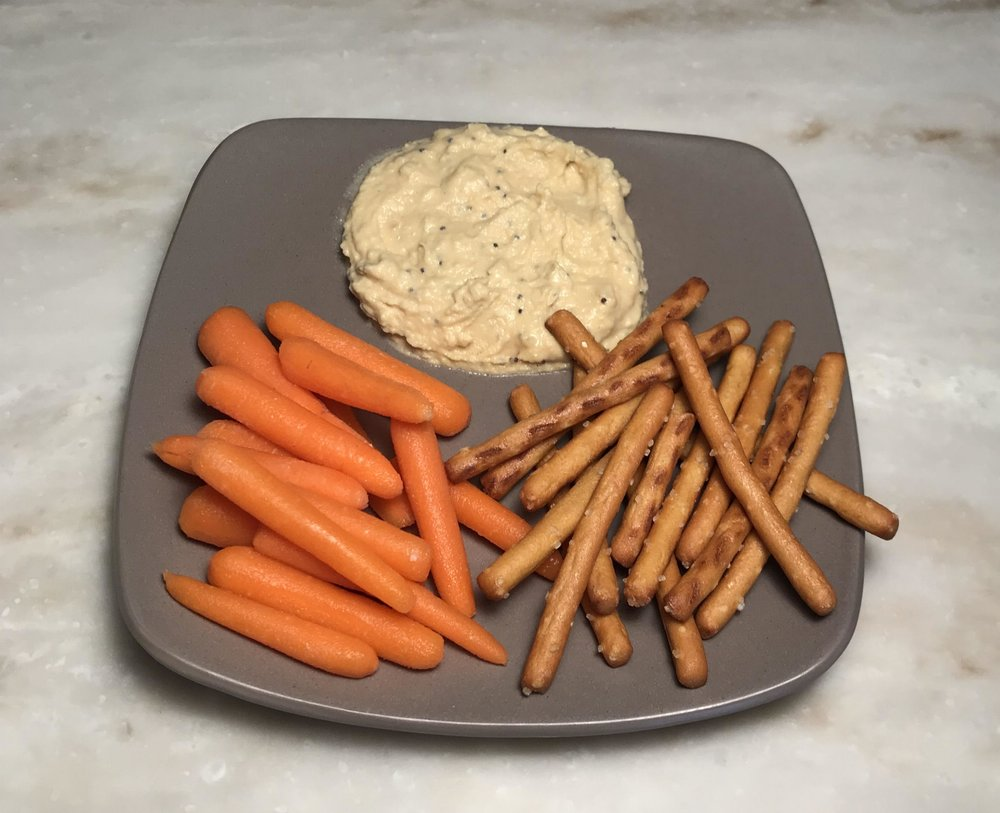 "Everything Bagel:  seasonings (sesame and poppy seeds, and dried minced garlic and onion) are added to the classic hummus. This savory hummus tastes ""just like an everything bagel."" Enjoy with crackers, pretzels or your favorite vegetables."