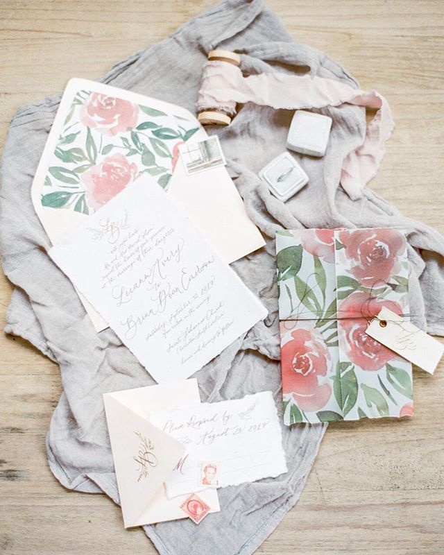 "Flashback to this romantic suite featured in @thebridaltheory AND @heyweddinglady last spring! 🌷Vellum paper printed with a custom watercolor painting to wrap the suite, cloth tags with the couple's monogram, handmade paper, and vintage stamps of course! I love adding the little details after the artwork, layouts and printing methods are all decided. I guess this transfers into my personal life too as Levi has been teasing me lately about all my ""add ons"" at coffee shops and restaurants. Like almond milk, avocados, extra veggies, and really anything else they offer haha. It's all about the extras I say ✨  Photo: @decorusfineart 