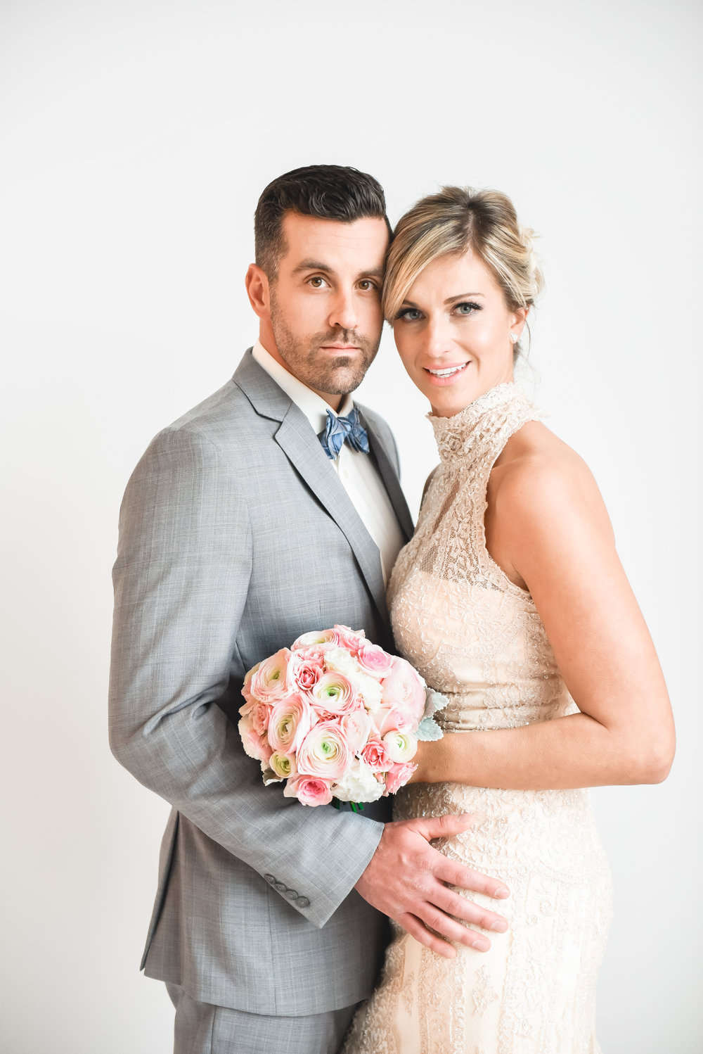 Julie Nicole Weddings . Model Jeff and Michelle of Maeck Weddings . Flowers by La Petite Fleur