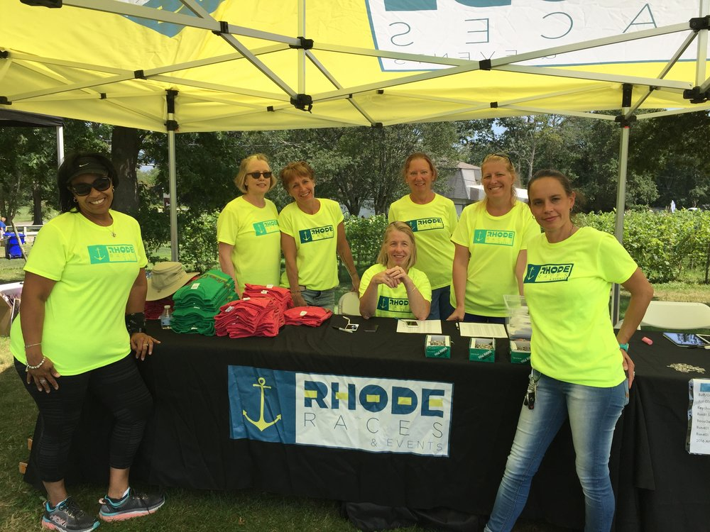 Rhode Race volunteer at their Wine Run 5k. June 2017
