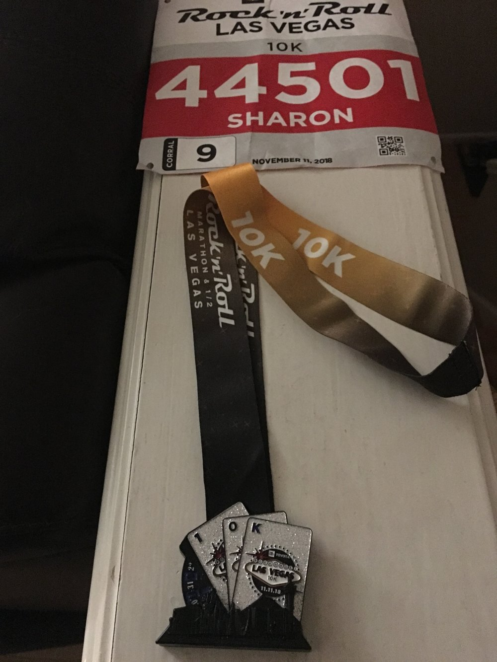 Race bib and 10k medal