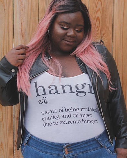 Deandra modeling a graphic t-shirt and gorgeous pink locks.