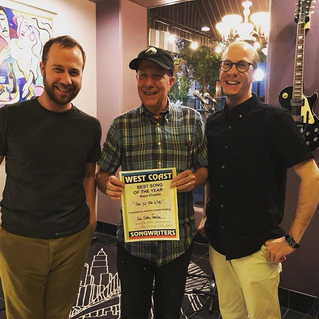 Napa, CA, Thursday, August 9, 2018: About a year and a half ago, Dad joined an organization called the West Coast Songwriters. One part of this group, which spans most of the west coast of the US, puts on a competition series. There's a Napa chapter (and a dozen more chapters up and down the coast) that gathers on the second Wednesday of each month. Two judges amble in and then songwriters arrive. They play their tunes for each other and the judges, and at the end of the evening one of the songwriters walks away with the award for best song of the month and a chance to compete in the Napa playoffs in August. If you win the Napa playoffs, you go to compete in the West Coast Songwriters Grand Finals at Freight and Salvage in Berkeley.  That brings us to Wednesday night.  Earlier in the year we won twice (the max you can win) for The State I'm In and Fire in the Wind. This was our second playoffs and it's obviously been a goal of ours to make it to the finals and play the Freight. As you've now surmised, we won! Fire in the Wind took the top prize and we're headed to Berkeley on Friday, August 24 for the Grand Finals.  You're invited to join us. We'll play a song of our choice and then Fire in the Wind. The other winners from each chapter will debut their songs too. It will no doubt be a night of great and inspired music. @westcoastsongwriters #westcoastsongwriters #folkmusic #napavalley