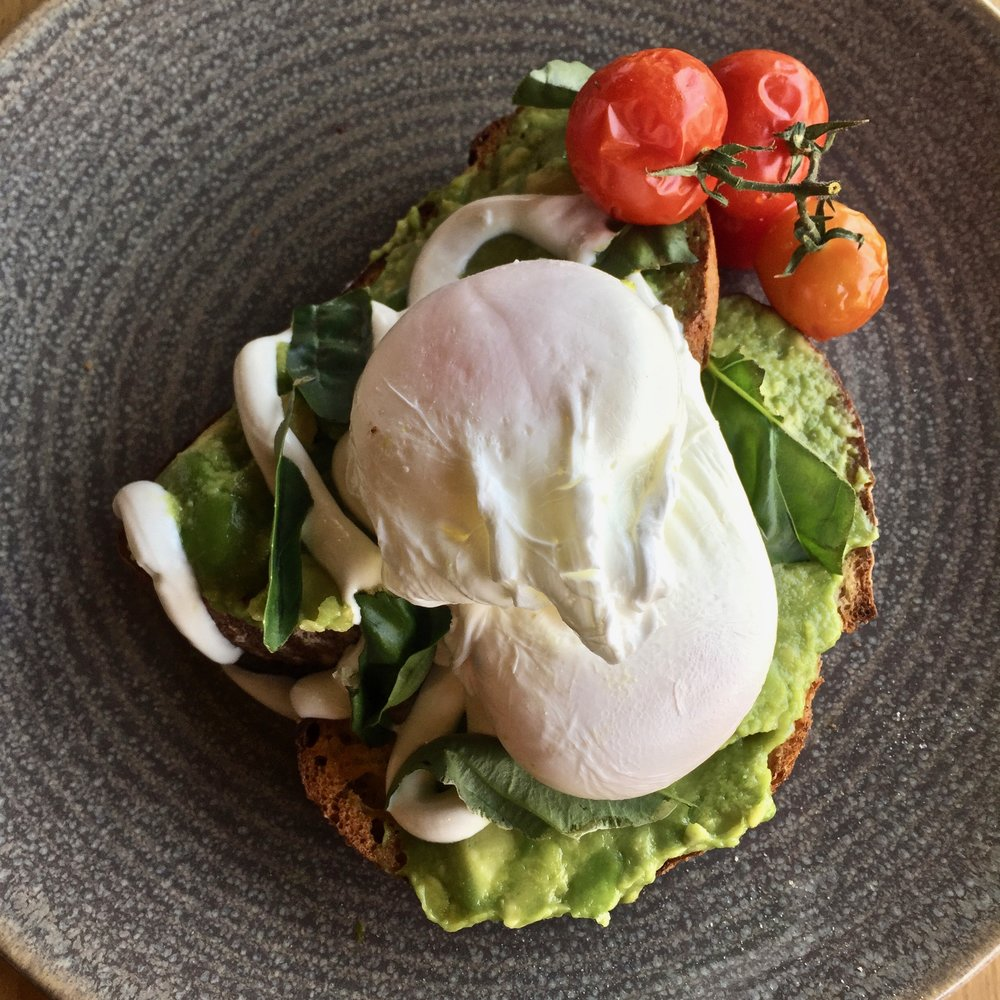 Avocado Toast with Poached Eggs, Goats Curd and Roast Tomatoes