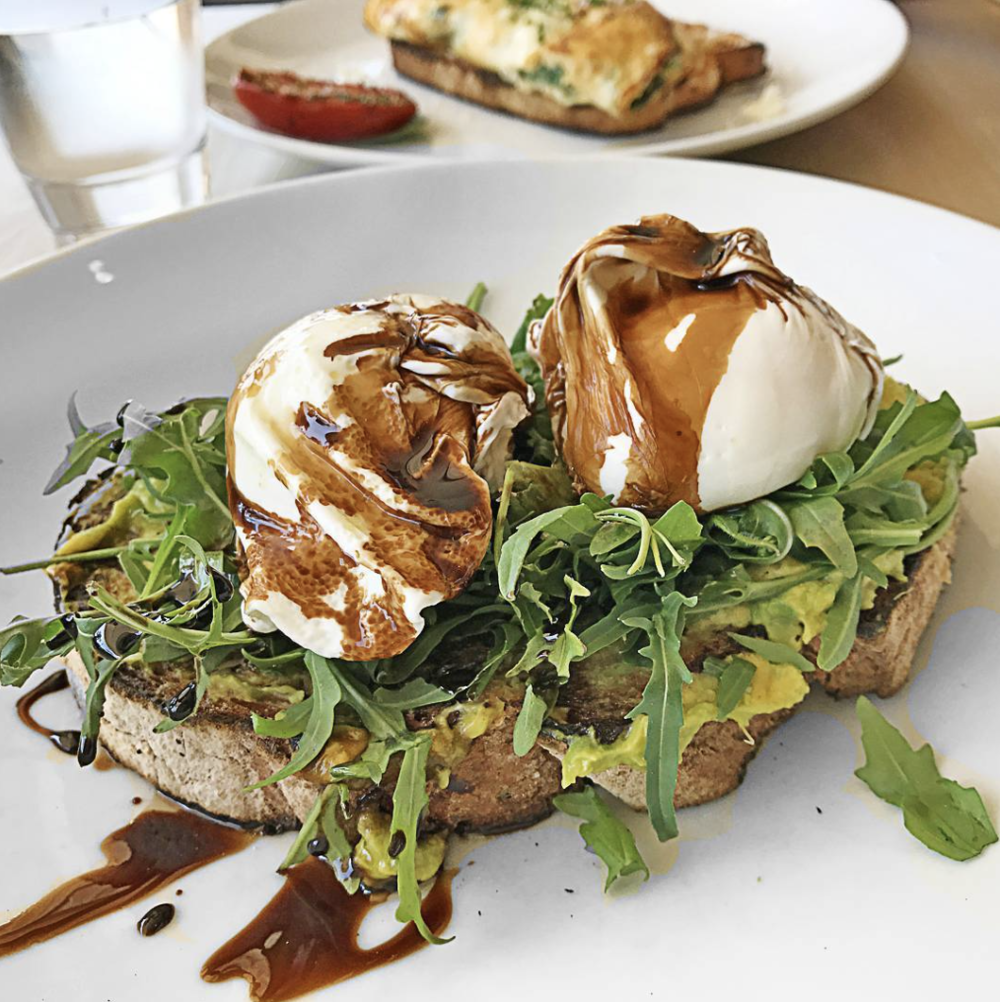 Poached Eggs on Rye with Mashed Avocado & Balsamic Rocket