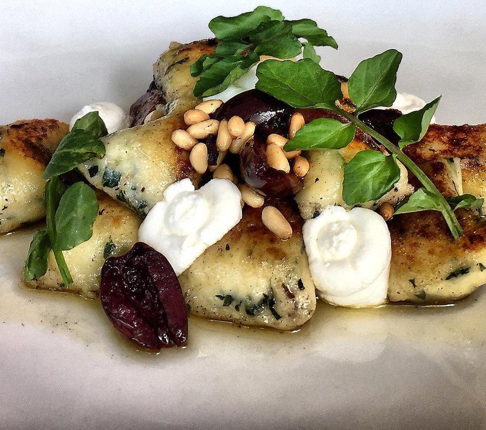 Pan Sautéed Potato & Spinach Gnocchi burnt butter, pinenuts, olives, goats curd.  Image courtesy of Woodland Kitchen & Bar.