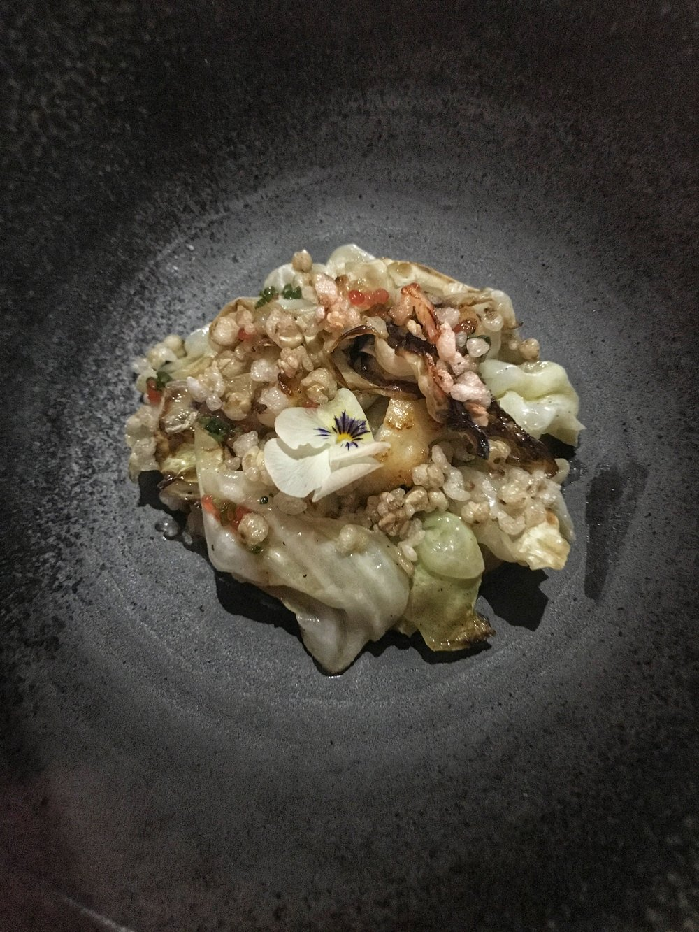 Princess Charlotte Bay bug dumpling with hispi cabbage, buckwheat, finger lime, nori and brown butter.