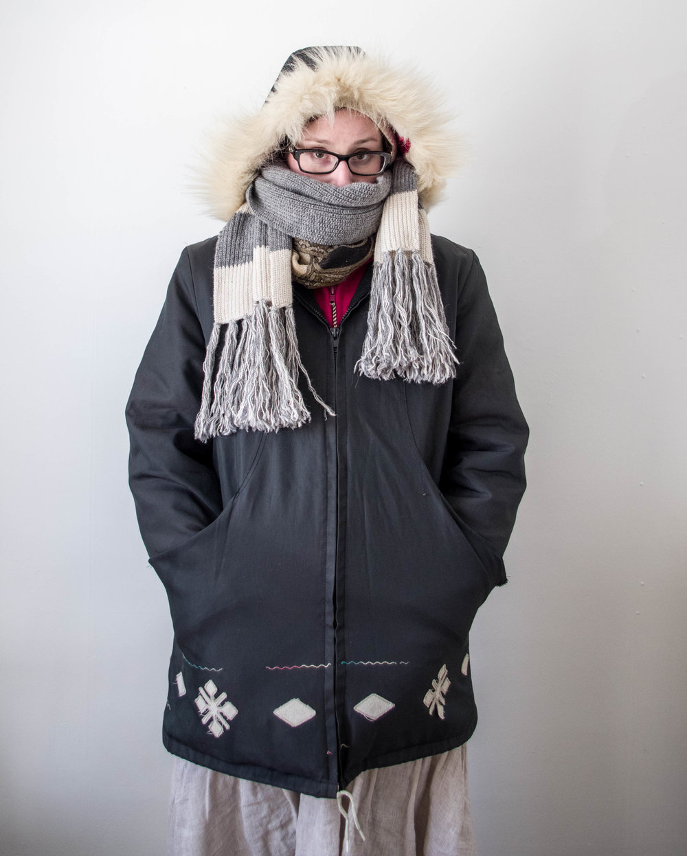 last winter's aesthetic, which will probably be the same as this winter's aesthetic - skirts over tights with thick socks on the bottom, three or four torso layers hiding underneath a two-layer parka that my mum bought several decades ago for the north, hands wearing handshoes and big mitts buried in pockets, hat covered by a double-layer hood with fur trim to block some of the prairie wind, pashmina wrapped around the neck and a scarf snagged from bryce covering most of my face. guaranteed my bones will still be cold when we get to this point.