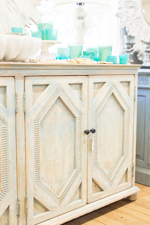 Rustic furniture, turquoise glassware