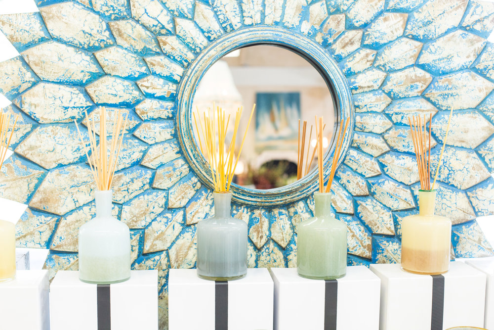 Turquoise mirror, colorful diffusers