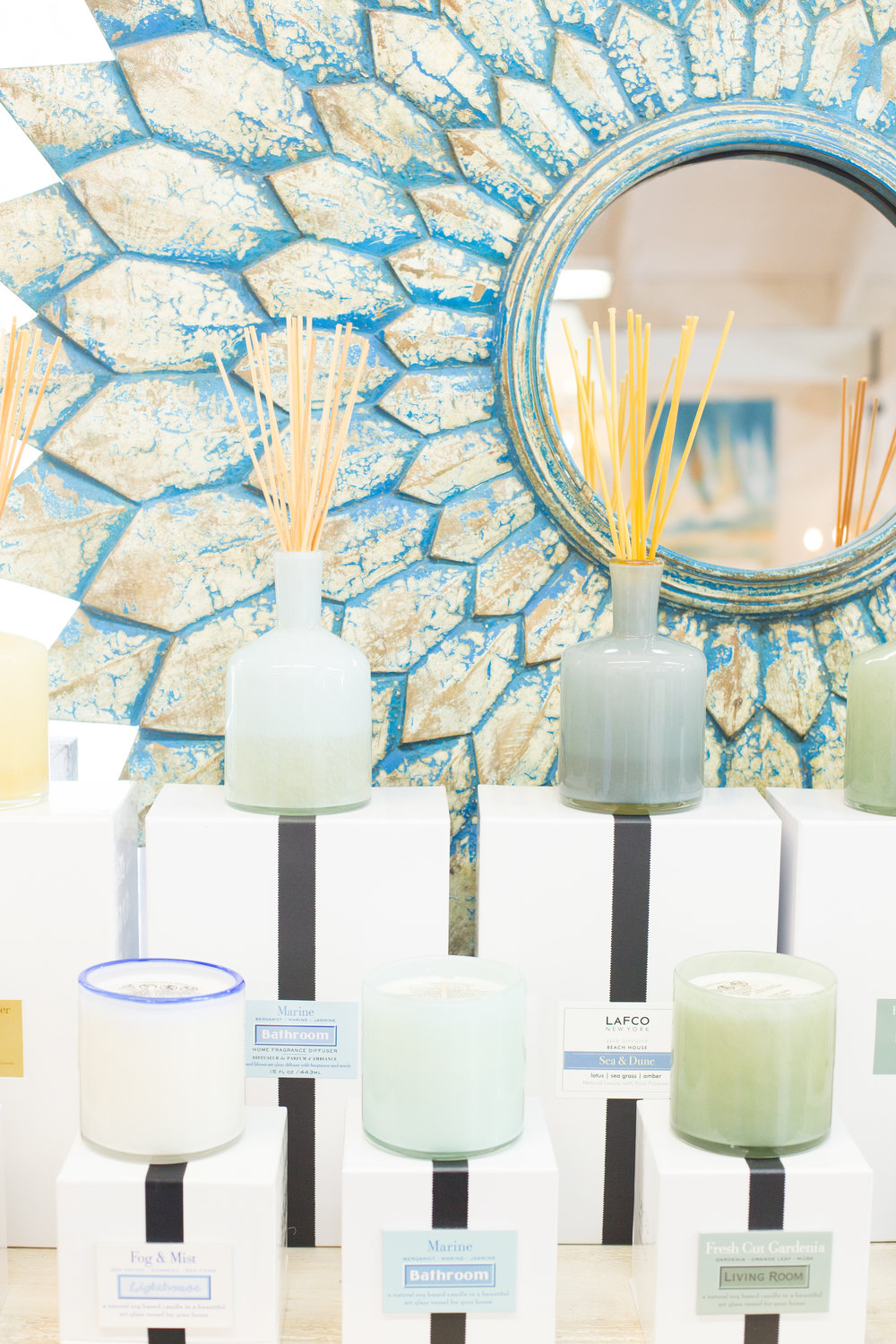 Sunburst mirror, turquoise candles