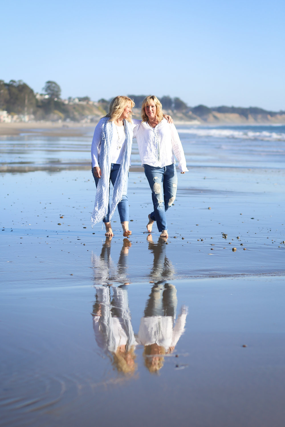 Twins walking on beach