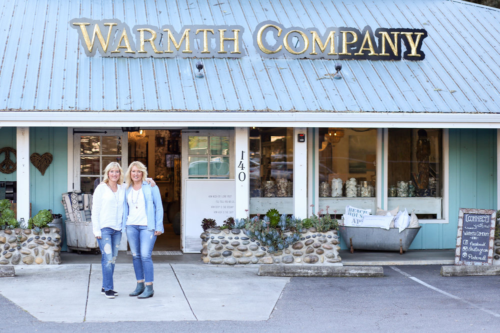 In front of Warmth Company storefront