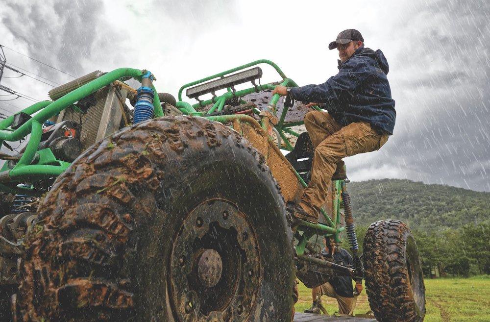 Man on Tractor Wearing Waterproof Gear