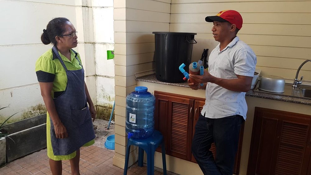 Image 2: Abundant Water's Timorese trainee Joanico Da Silva installing an Abundant Water at the residence of the Ambassador of the Timor-Leste Embassy in Vientiane, Natália Carrascalão.