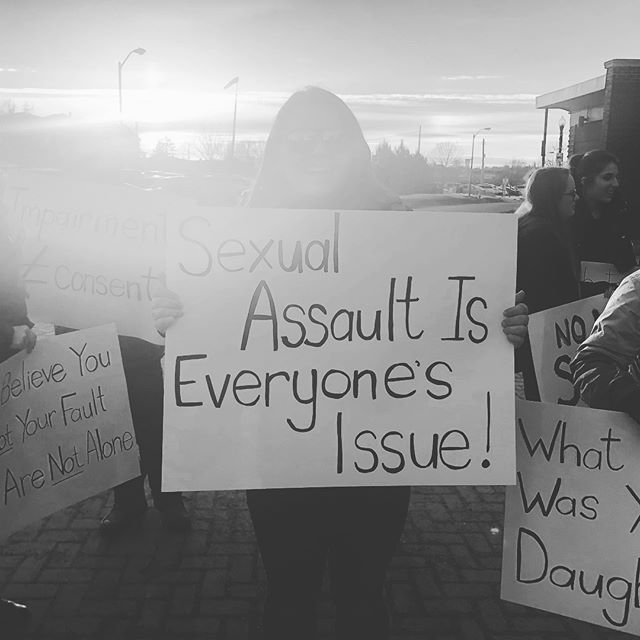 When we raise our voices we reclaim our power 🖤 __ A photo from our protest in Sudbury, ON when local officials refused our request to cancel the upcoming Hedley concert following multiple sexual assault allegations from the bands front man, Jacob Hoggard. In the weeks following our peaceful demonstration Hoggard was arrested and charged on multiple accounts of sexual assault in Toronto, ON.  __ There may be moments when it feels like no one is listening. We believe you.  On this day we were only 50 people strong. Together we shared a message with survivors in our community that they are never alone.  Your voice matters.  We're Stronger Together.  #shematters #strongertogether #sudbury