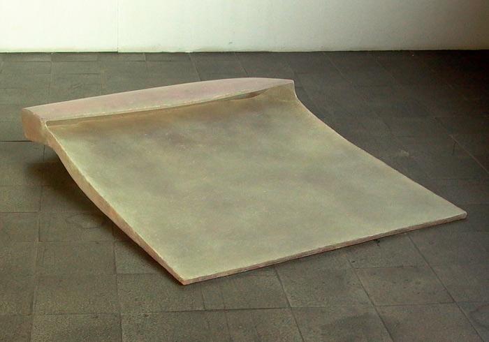 Unroll . 2006  Polyester resin. Dimensions: 20 x 105 x 110 cm