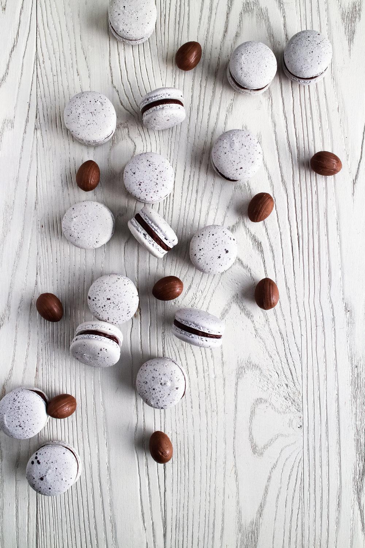 Creme Egg Macarons - classic vanilla bean shell with Cadbury creme egg chocolate ganache by Fox and Crane