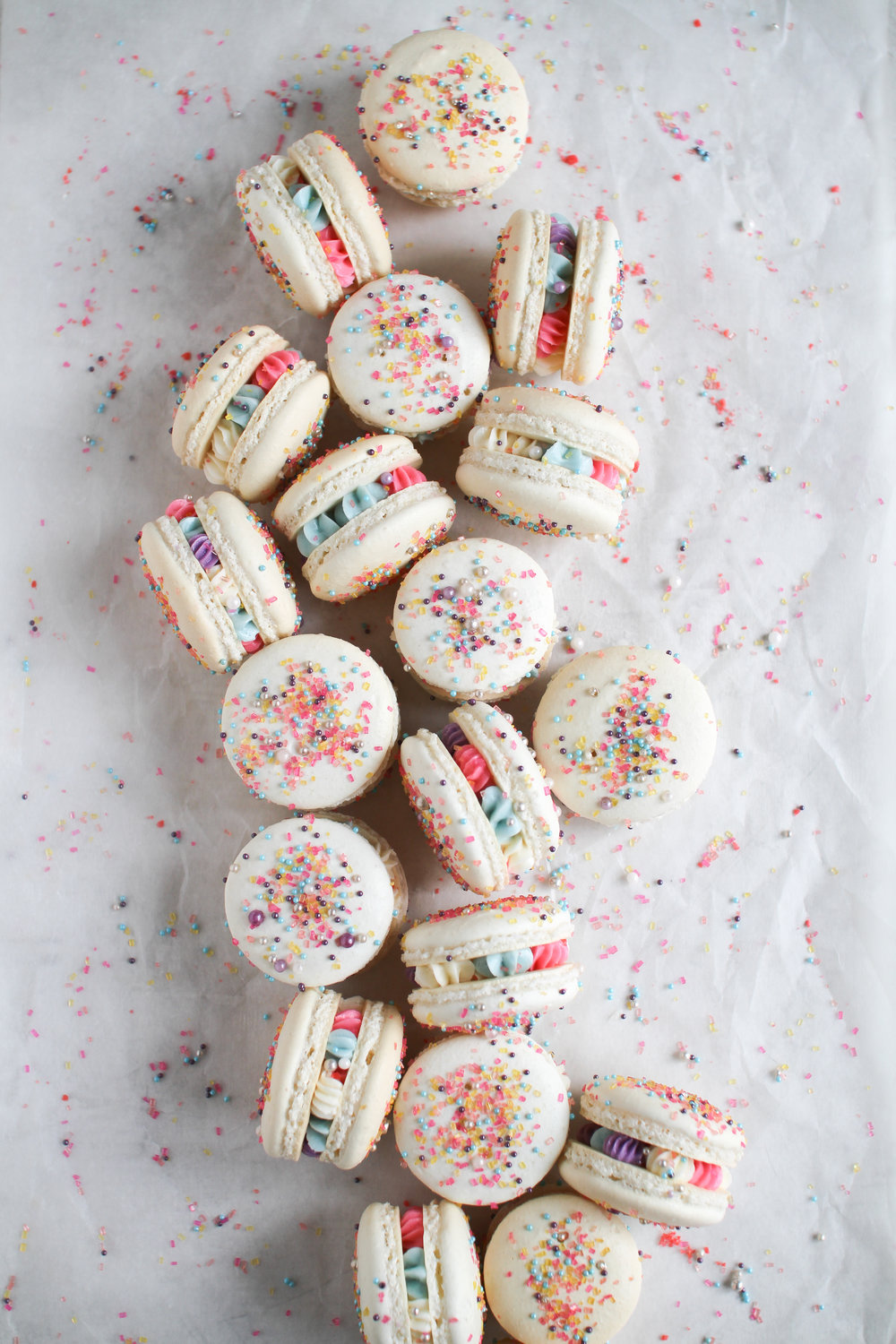 New Year's Celebration Macarons - classic vanilla shell with Heilala vanilla bean swiss meringue buttercream and pop rocks candy center by Fox and Crane - foxandcrane.com