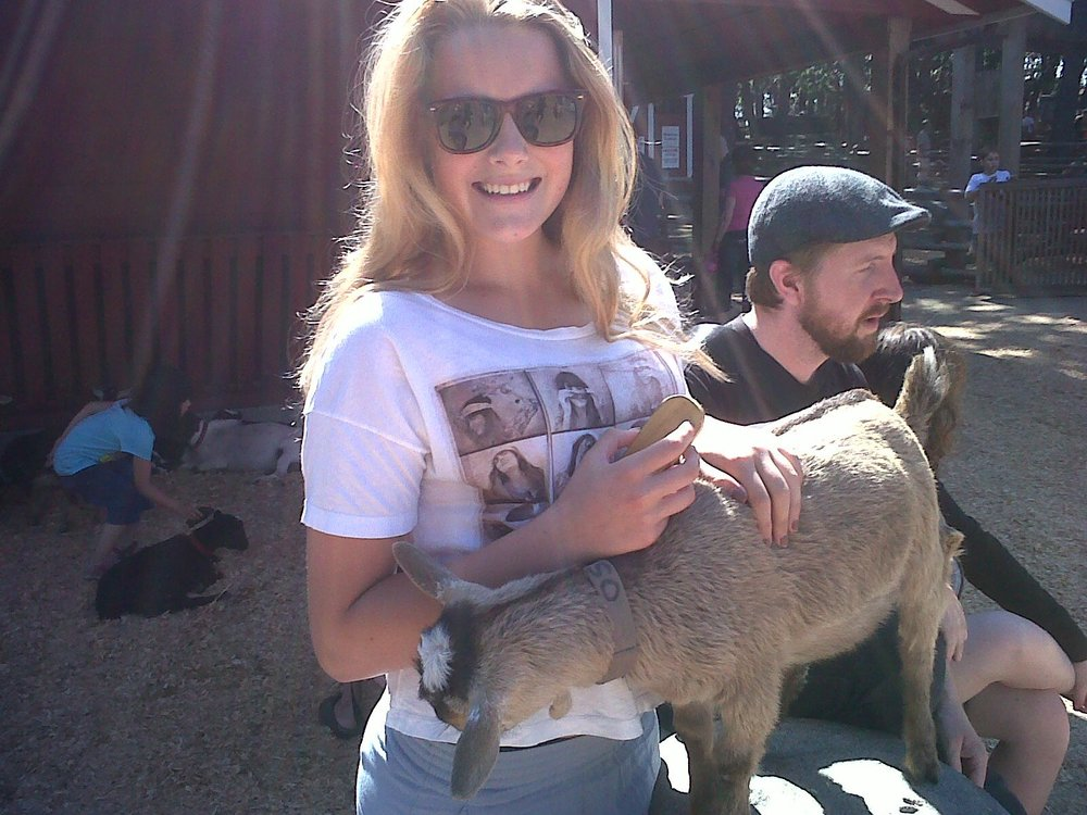 Sun-tanned and hopeful Sam featuring Oscar the Goat c.2011. Btw I lost all of these items of clothing within two weeks - except the sunglasses which I continue to wear to this day.