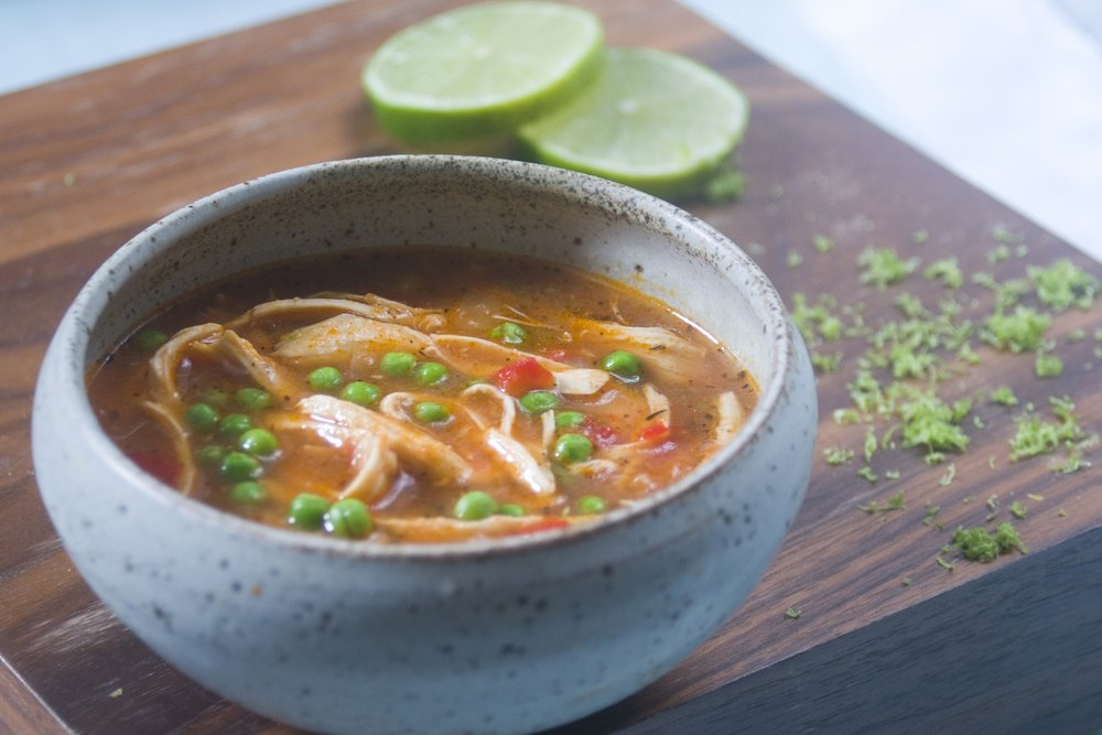 spicy turkey soup with lime, peppers and peas -