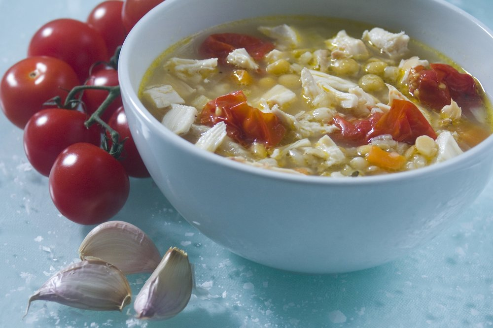 chicken and barley broth with garlic and tomatoes -