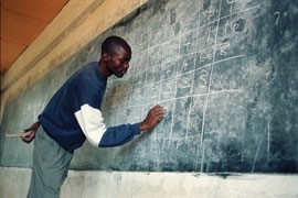 Fredrick Ochieng, the assistant principal, math teacher and bookkeeper at the secondary school, teaches a math lesson at St. Timon's secondary school in Rabondo.
