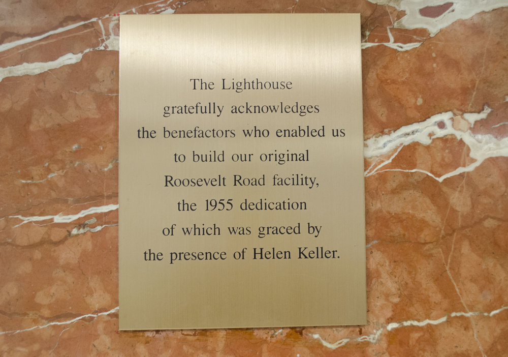 A plaque on a wall in The Chicago Lighthouse commemorates Helen Keller's visit and dedication to the facility in 1955.