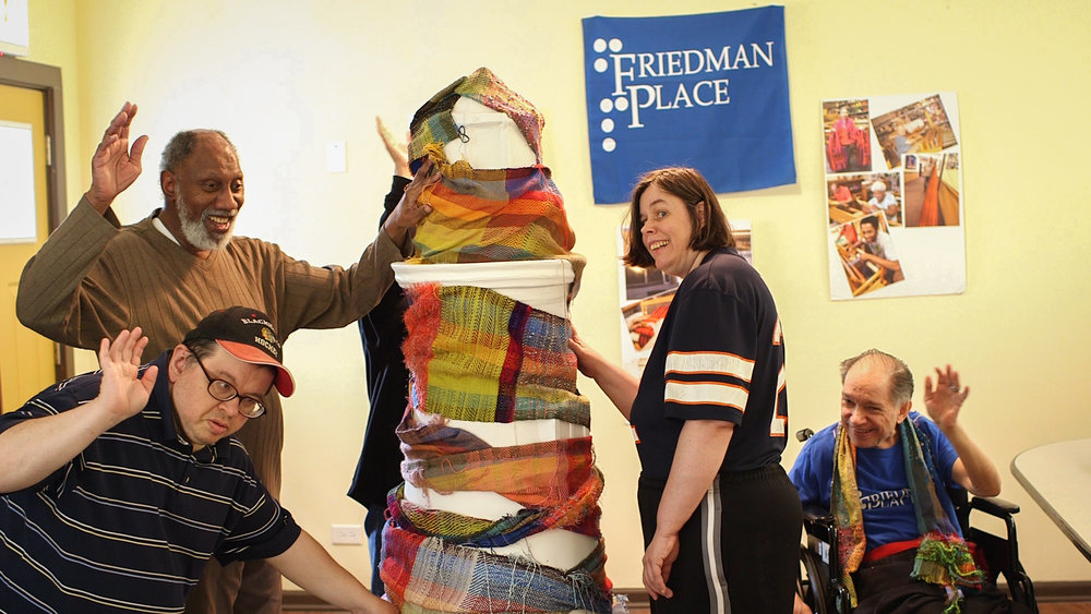 Twelve artists with The Blind Weavers of Friedman Place worked together to create the sculpture titled Our Woven Lighthouse that is currently on display as part of Lighthouses on The Mag Mile, a public art display celebrating access and inclusion for people with disabilities.