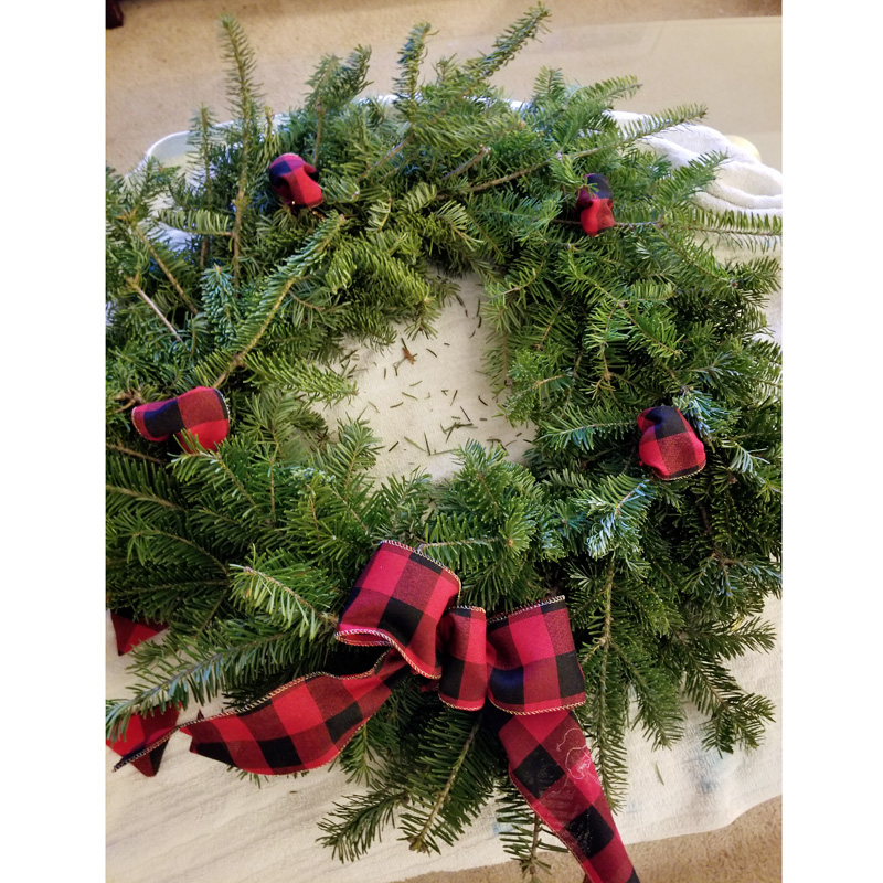 Step 11 - Admire your work. Great job. Go hang it up! If there is not already a loop in the back for hanging you can use an over door hook specifically designed for holding wreaths or add a small piece of ribbon or rope around the top.