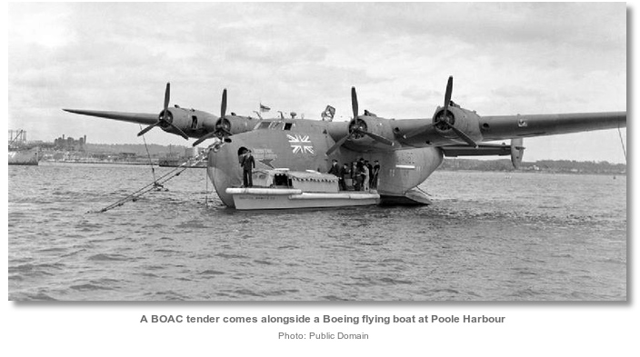 a_boac_tender_comes_alongside_a_boeing_flying_boat_at_poole_harbour.jpg