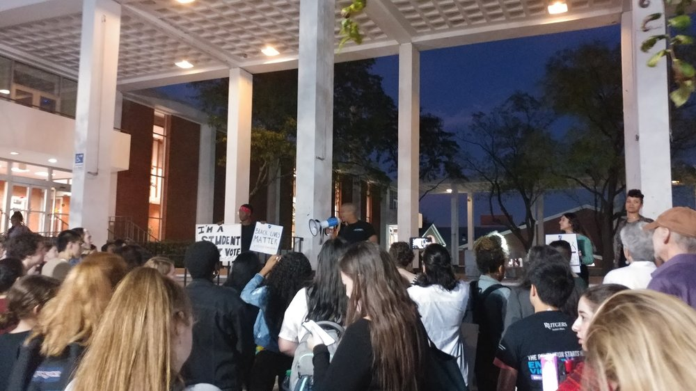 Protesters gathered in front of the dining hall to voice their concerns.
