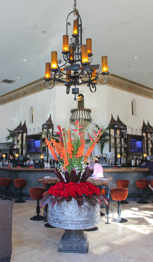 Entry at Zocalo Sacramento with flowers and ornate iron chandelier