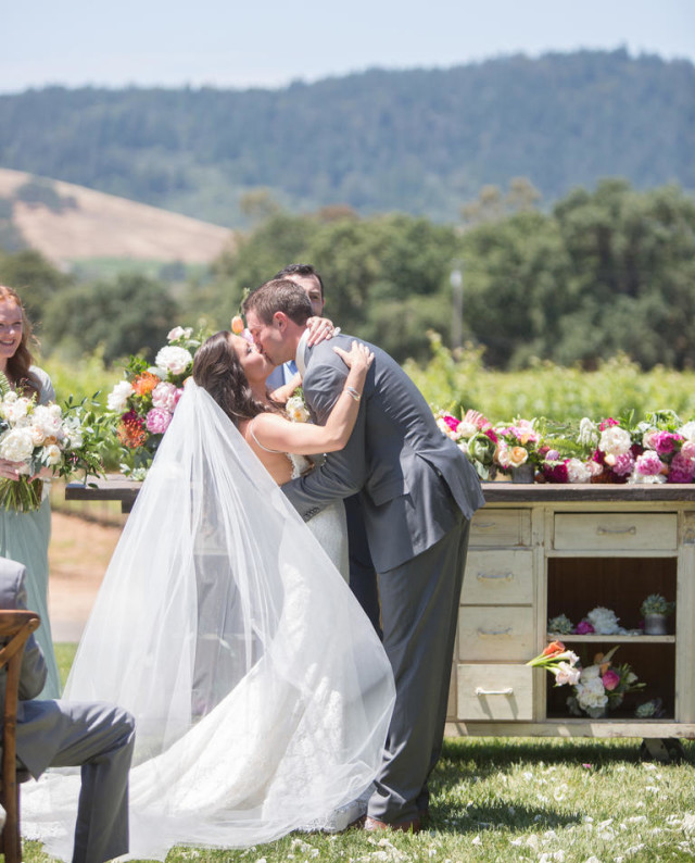 The-knot-throws-a-wine-country-wedding-stylemindchic-jasminestar- with a bridal kiss