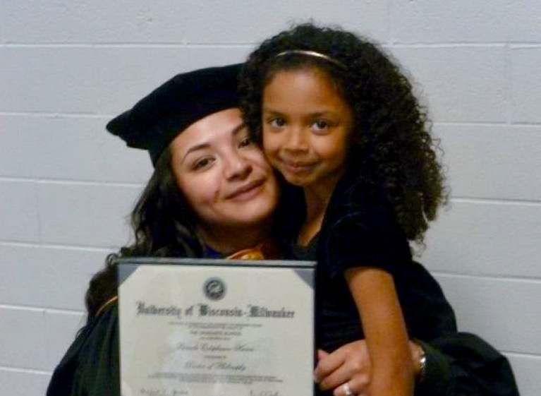 Dr. Pamela E. Harris with her daughter Akira during her PhD graduation.