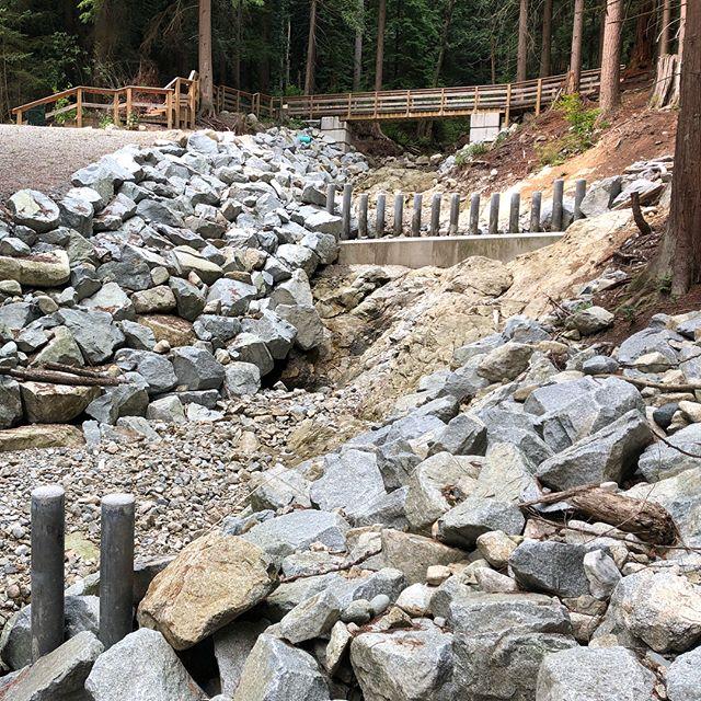Kilmer Creek Basin 2 years later! One of our tougher jobs battling steep terrain, rain, flash floods, snow.. #civilconstruction #gravityconstruction #districtofnorthvancouver
