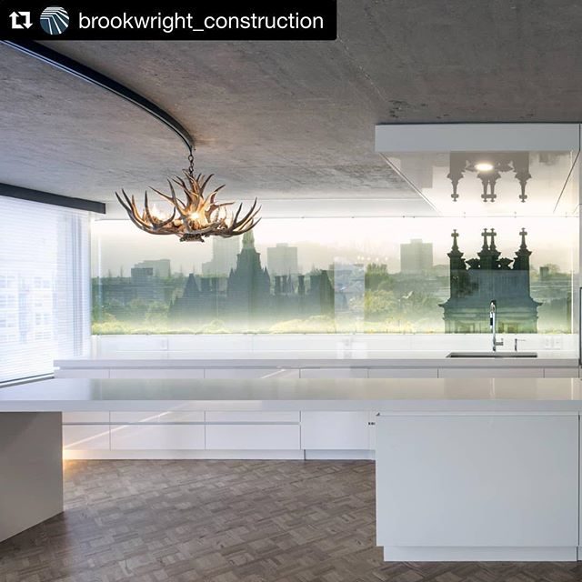 Proud to supply the Backlit graphic for  @brookwright_construction ・・・ #mondaymoments! The architects on this project worked with the clients to select this backlit graphic which does a few great things for the space. 1. It extends the window wall to the left and makes the room feel more open. 2. It reminds the clients of a trip they took to #Scotland (where they took this photo!) 3. It adds some awesome glowy indirect lighting in the kitchen area! . Design  @the_mbac 📷 @yellowcameranika ⚒️ #Brookwright . #architects #architecture #lighting #lightingdesign #interiordesign #design #edinburgh #graphic #interiors #yycdesign #yyccondo #missionyyc #yycconstruction #yycrenovation  #renovation #construction #backlit #photography #light #scenery #whitekitchen #modern #yycmodern #antlers #parquetfloor