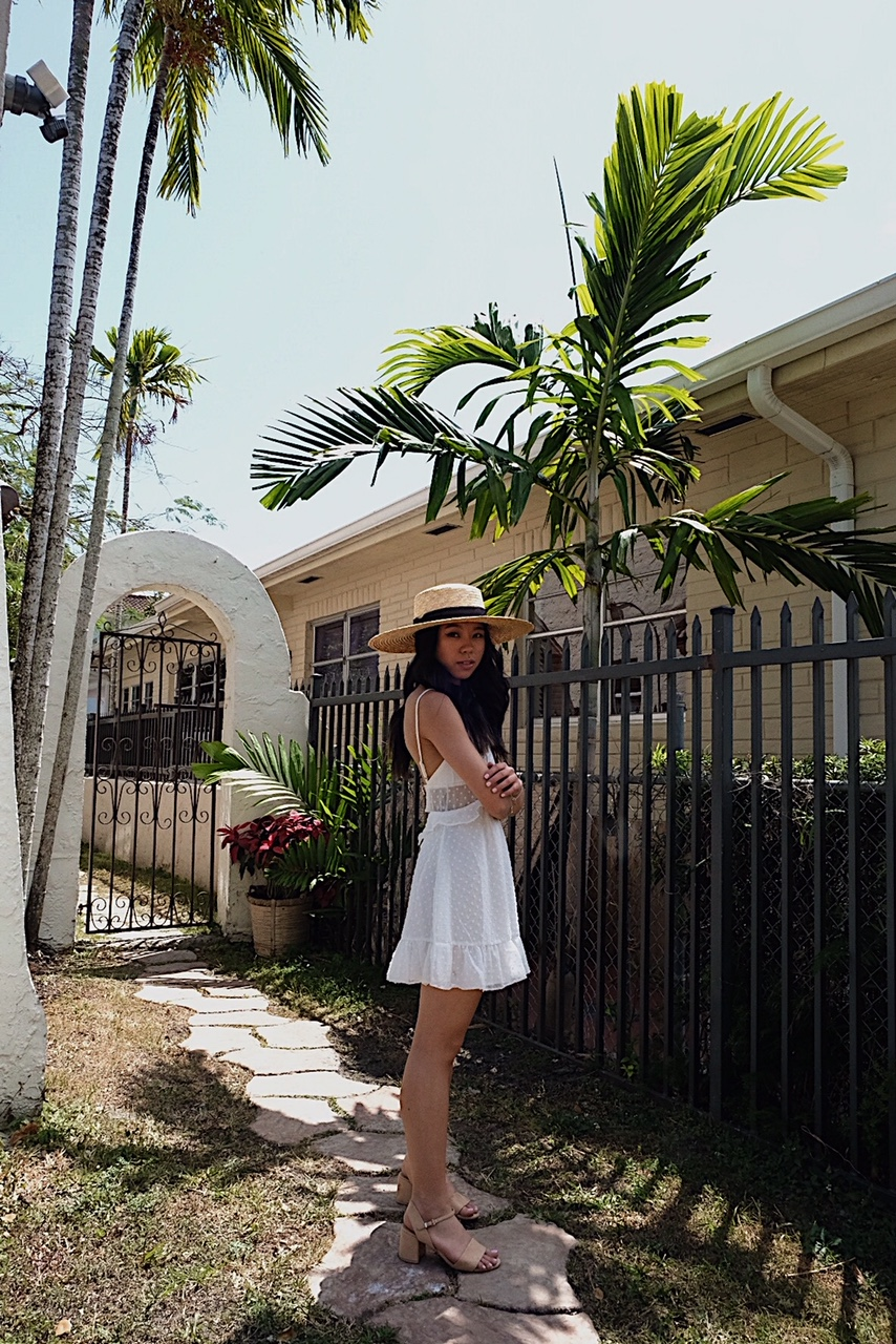 Wearing  Majorelle X Revolve  dress,  Zara  sandals, and  Lack of Color  hat