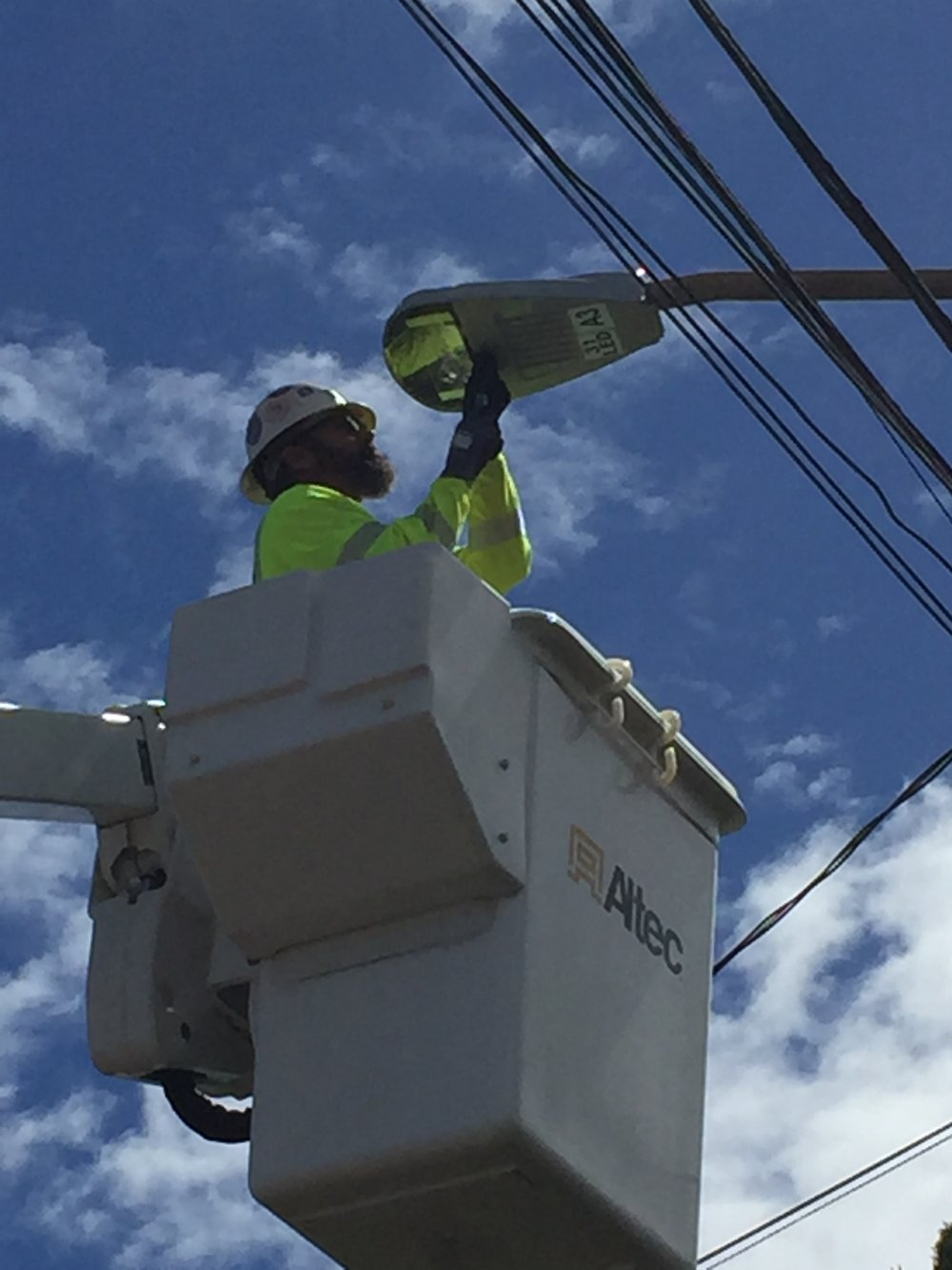 Installing New LED Street Light on Hukilau Loop.JPG