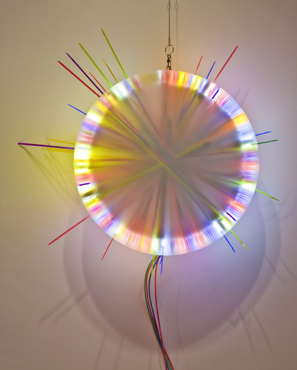Mixed Pair (Breakup) A   Fluorescent Lamp, color snap ties, loom heddles and fishing spinners and color wire 16 in lamp diameter 24 in overall