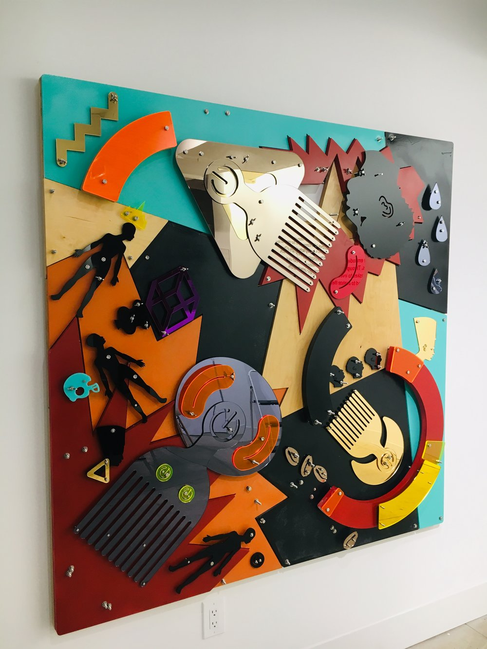 Improbable Cause (Blackamoors Collage #)   Plexiglass, Mirror, Stainless Steel and red oak board 60 x 60 in